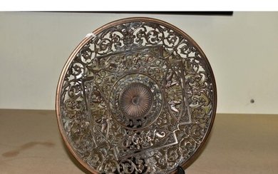 A CAST IRON DISH WITH PIERCED DECORATION, MARKED 'COALBROOKD...