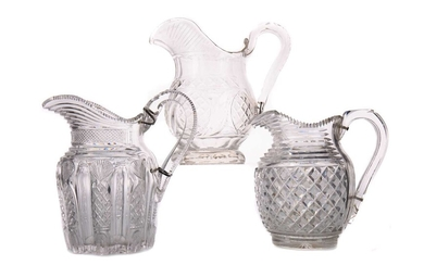 A COLLECTION OF THREE EARLY 19TH CENTURY CUT GLASS JUGS