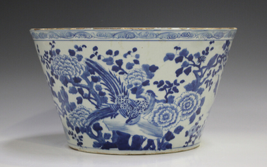 A Chinese blue and white porcelain bowl, mark of Kangxi but later Qing dynasty, of circular tapering