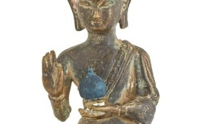A Chinese or Southeast Asian Bronze Figure of Buddha