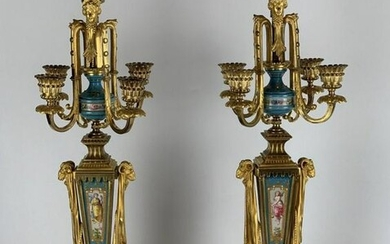 A PAIR OF JEWELED ORMOLU MOUNTED SEVRES CANDELABRA