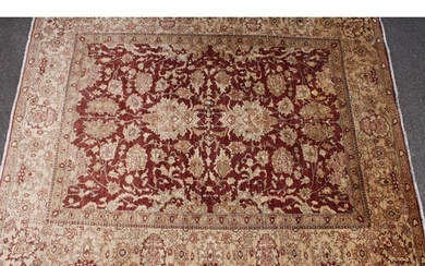 A Pakistan woollen carpet, worked in the traditional manner,...