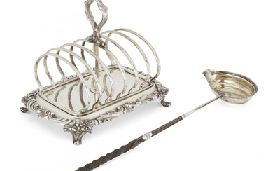 A Victorian silver toast rack, London, c.1840, Robert Hennell III, the six divisions centred by a stylised branch loop handle, the base with floral and scroll edge raised on four scroll feet, 19cm long, together with a silver toddy ladle with...