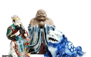 A collection of Chinese porcelain figures, to include a blue...