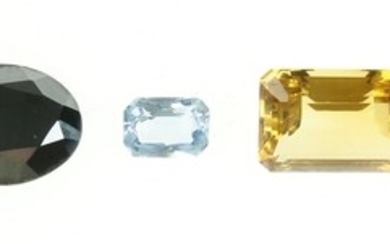 A collection of gemstones: two synthetic blue spinels, one cushion-cut...