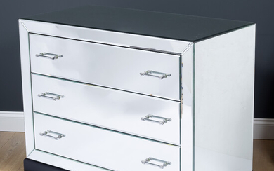 A contemporary mirrored three drawer chest