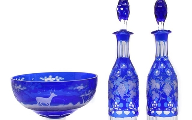 A pair of Bohemian glass overlay decanters