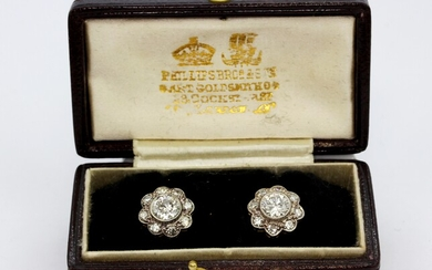 A pair of boxed yellow and white metal (tested high carat gold) cluster earrings set with brilliant cut diamonds, approx. 2.25ct, Dia. 1.1cm