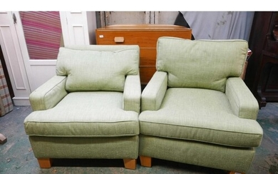 A pair of contemporary armchairs, raised on oak block suppor...