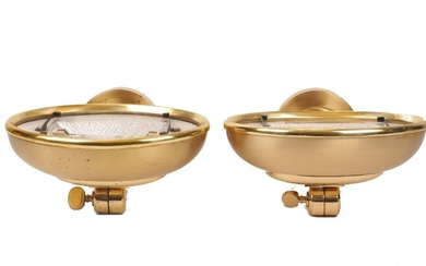 A set of five brass uplighter wall lights, of recent manufacture, with adjustable domed shades on curved arms with circular back plates, 11cm high, 25cm wide, 26cm deep