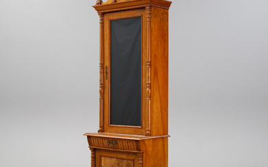 A walnut book cabinet, end of the 19th Century.