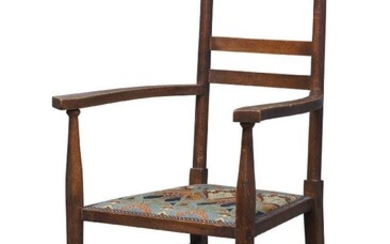 An Arts and Crafts oak armchair, c.1905, The backrest with shaped and pierced crest above two rails and later upholstered Art Nouveau pattern seat, on cylindrical supports united by tapered stretchers, 107cm high, 56cm wide, Provenance - by repute...
