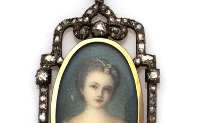 An antique gold and silver miniature pendant