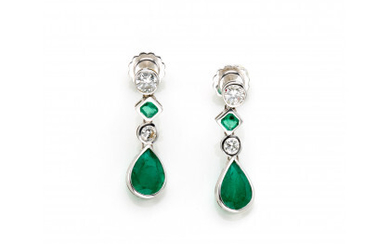 White gold pendant earrings with round diamonds in all ct. 0.70 circa and pear and octagonal shaped emeralds, g 4.87…Read more