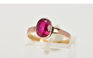 A 22CT GOLD VICTORIAN DRESS RING, set with an oval cut synth...