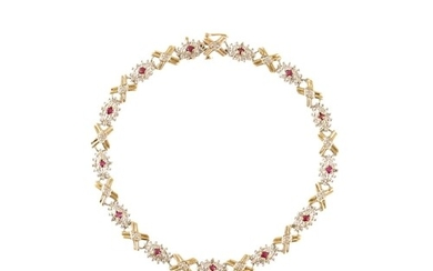 A DIAMOND AND RUBY CLUSTER BRACELET, mounted in gold