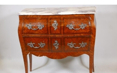 A French Louis XV style marquetry inlaid tulipwood bombe sha...