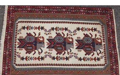 A Persian or Iranian rug, worked in the traditional manner, ...