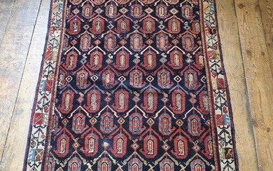 A Persian red ground rug, main cream border, centre with rep...