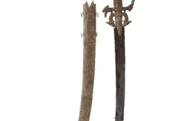 A gem-set silver and gold Singhalese steel sword (kastane) and scabbard, Sri Lanka, 17th century, 60cm. high This kast?né (A Sinhalese sword with a short curved blade) is a ceremonial sword, part of the official dress of Sinhalese who served the...