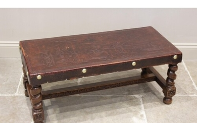 A leather topped South American table on barley twist suppor...