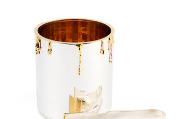 A novelty silver ice bucket and tongs