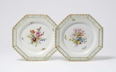 A pair of Berlin KPM porcelain plates from a dessert service with wildflowers and insects