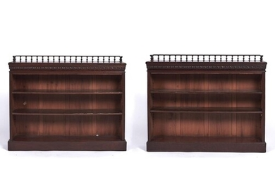 A pair of Edwardian mahogany open bookcases, the rectangular...