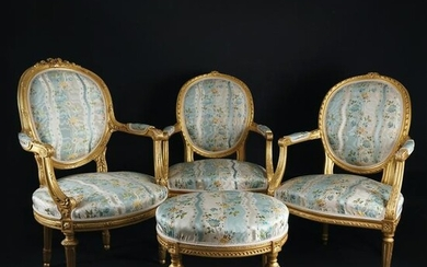 A pair of carved gilt wood armchairs