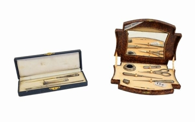 A silver sewing and silver writing set