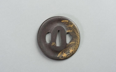 AN IRON TSUBA WITH REED AND LEAF
