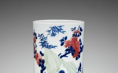 AN UNDERGLAZE-BLUE, COPPER-RED AND CELADON-GLAZED CARVED BRUSHPOT, QING DYNASTY