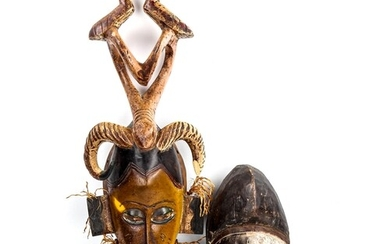 An African carved and painted wood mask, height 73cm, and an...