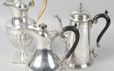 An Edwardian silver coffee pot, together with a late Victorian lidded jug and a further lidded jug. (3).