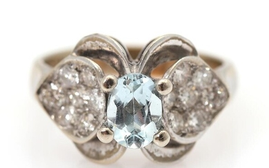 An aquamarine and diamond ring set with an oval-cut aquamarine flanked by numerous brilliant-cut diamonds, mounted in 14k white gold. Size 55. – Bruun Rasmussen Auctioneers of Fine Art