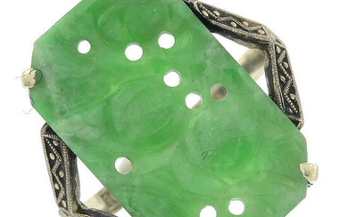 An early 20th century 9ct gold carved jadeite ring.