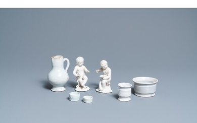 Four white Dutch Delftware ointment jars, a jug and two figu...