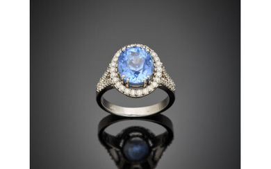 *Oval ct. 6.22 sapphire and diamond white gold cluster ring, diamonds in all ct. 0.45 circa, g 7.89 circa size 16/56. Appended gemmological report AIGS n. GF20120510 23/12/2020
