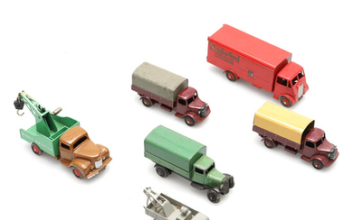 THREE DINKY COVERED WAGONS AND OTHER FREIGHT VEHICLES.
