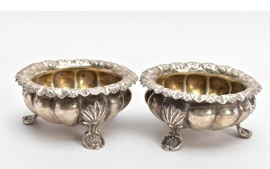 TWO SILVER BONBON DISHES, each with an embossed bowl, worn g...