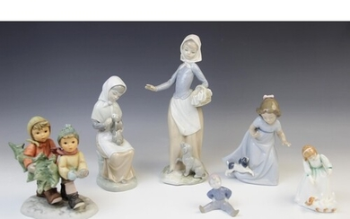 Two Nao figures, one modelled as a girl and puppy, 16.5cm hi...