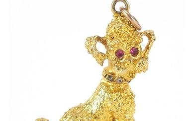 9ct gold seated poodle charm with ruby eyes, 3cm high, 8.7g