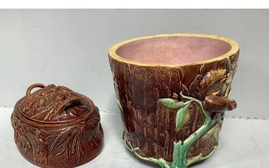 A 19th century Majolica pottery jardiniere modelled as a tre...