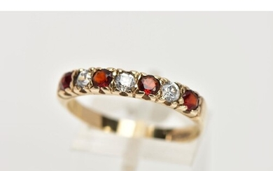 A 9CT GOLD GARNET AND CUBIC ZIRCONIA HALF ETERNITY RING, des...