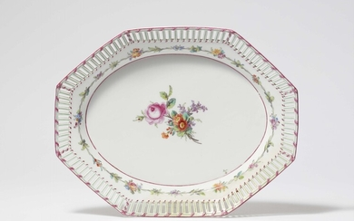 A Berlin KPM porcelain dessert plate from a service with a purple ribbon and flowers