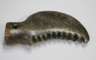 A Chinese archaistic jade ceremonial blade of curved crescent form with serrated edge, the stone of