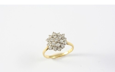 A DIAMOND CLUSTER RING set overall with circular-cut diamond...