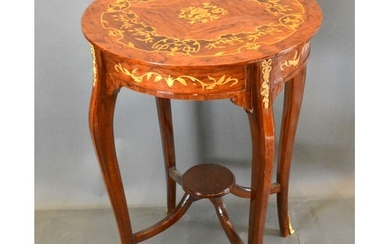 A French style marquetry inlaid gilt metal mounted circular ...