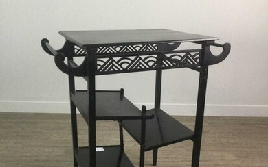A LATE 19TH CENTURY EBONISED TIERED OCCASIONAL TABLE IN THE MANNER OF E. W. GODWIN