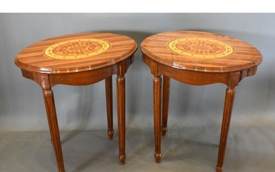 A Pair of French marquetry inlaid oval lamp tables each with...